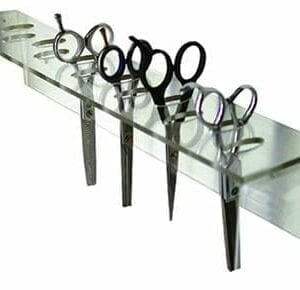 Wall mounted scissor holder.